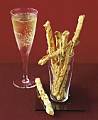 Spicy cheese sticks and a glass of champagne