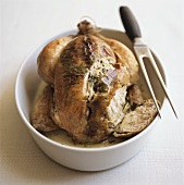 Roast chicken with meat fork
