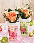Roses with white pine in coloured beakers with fir motif