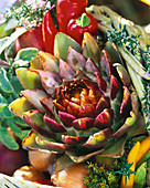 Table decoration with artichoke, onions and peppers