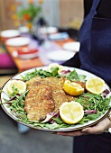 Veal escalopes in Parmesan panade on rocket