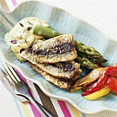 Herring with herb stuffing, asparagus, peppers and aioli