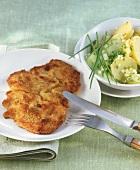 Wiener Schnitzel (veal escalope) with potato & cucumber salad