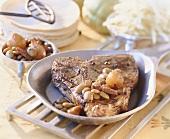 Grilled veal T-bone steak with olives
