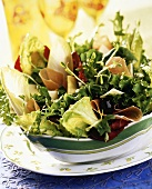 Mixed salad leaves with ham