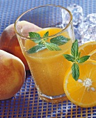 Orange and peach drink with mint
