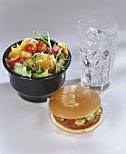 Hamburger with mixed salad and iced water