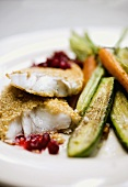 Fish with sesame crust, vegetables and cranberries