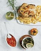 Chicken with rosemary potatoes, tomatoes and capers