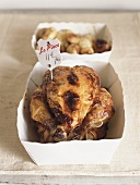 Roast chicken with price label in cardboard box