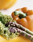 Still life with green asparagus, lollo biondo & pepper