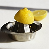 Lemon half on lemon squeezer