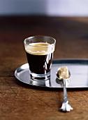 Espresso in glass and brown sugar cube