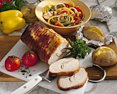 Mustard roasted pork with baked potatoes and pepper salad