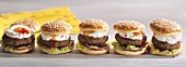 Hamburgers with fresh cheese cream in a row