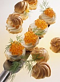 Profiteroles with fresh cheese filling and trout caviare
