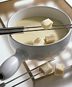 Neuchâtel fondue with cubes of white bread