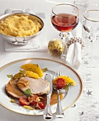 Roast pork roll with polenta and orange ragout