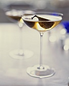 Two glasses of champagne with fig