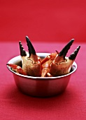 Crab claws in a small bowl