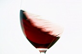 Red wine being swirled round in glass
