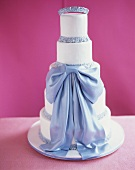 White marzipan cake with pale-blue bow