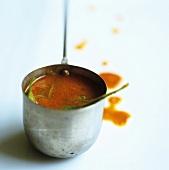 Ladleful of tomato soup