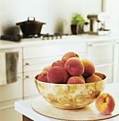 Peaches in a bowl in a kitchen