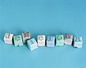 Petit fours with the word 'delicious'