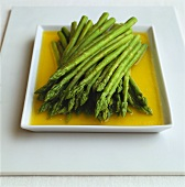 Green asparagus in melted butter