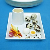 Quails' eggs with vegetable sticks and dip