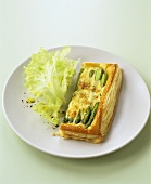 Green asparagus and cheese tart with puff pastry crust
