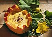 Pumpkin cream soup in hollowed-out pumpkin