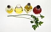 Oil and vinegar bottles and chervil