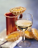 Saffron tarts and a glass of white wine