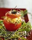 Tomato stuffed with salmon on rocket and cress salad