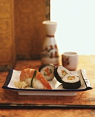 Maki-sushi and nigiri-sushi with rice wine