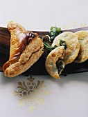 Puff pastry spinach pie and pasta cakes with herbs