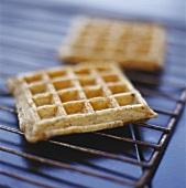 Freshly baked waffles on rack