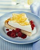 Lemon tart garnished with raspberries