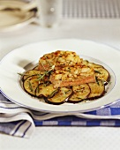 Roast beef on aubergine slices with gratin topping