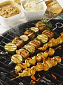 Chicken saté and fish kebabs on barbecue