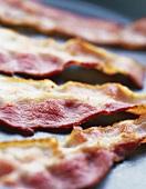 Rashers of fried bacon