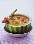 Cold melon and mango soup in hollowed-out melon