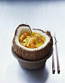 Curried coconut soup with shrimps in coconut