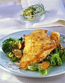 Fried fish with vegetables and herbs