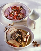 Porridge with apple and muesli with strawberries and nuts