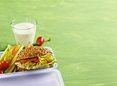 Vegetable sandwich in wholemeal bread and a glass of milk
