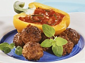 Meatballs with chili dip in pepper half