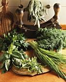 Still life with fresh herbs and mezzaluna